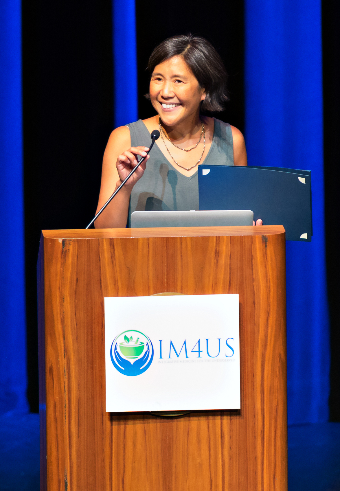 Dr. Maria Chao welcoming IM4US attendees. Photo by Kathleen Harrison.