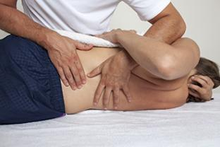 Patient receiving spinal manipulation treatment