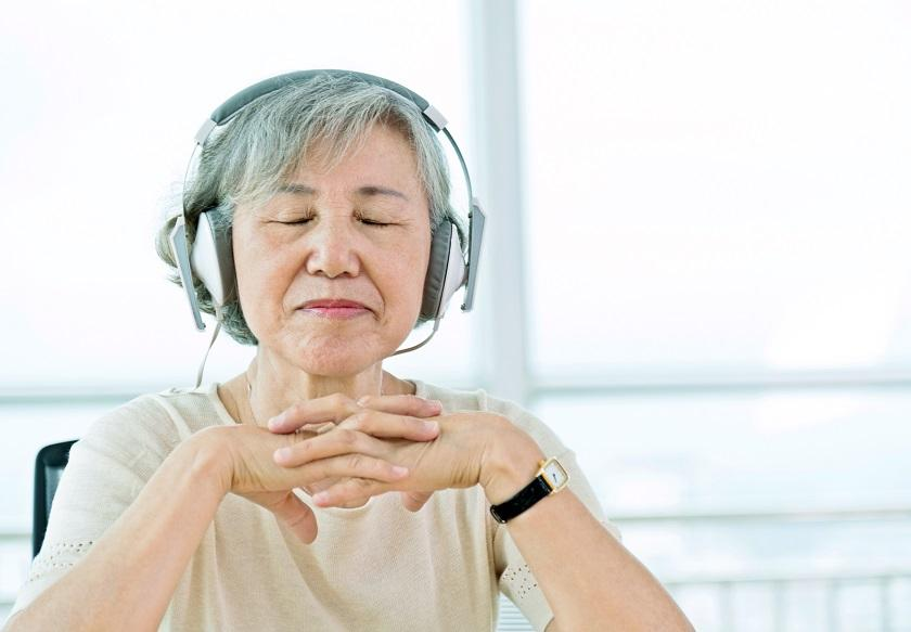 Person listening to guided meditation with headphones