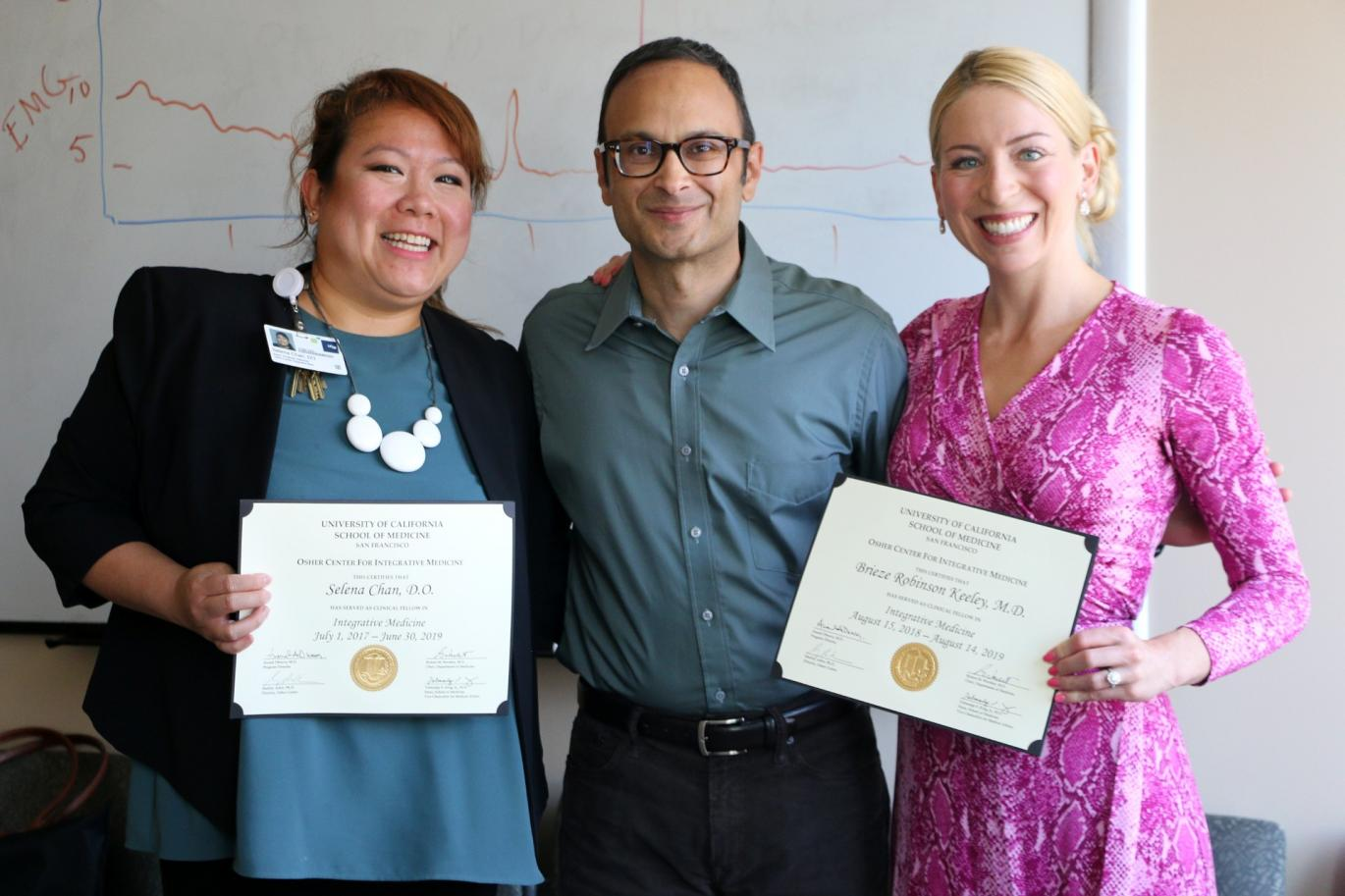 Clinical Fellows receive certificates from Education Director